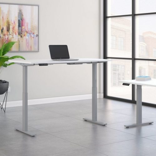 height adjustable standing desk in white with cool gray metallic base in office