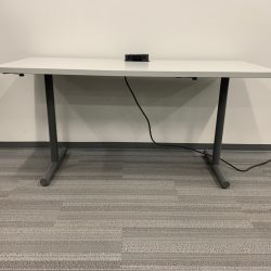 grey and black desk with power mount