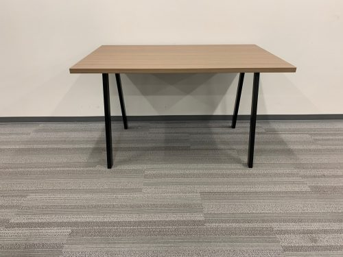 light brown table with oblique legs 1