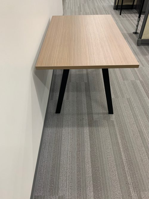 light brown table with oblique legs 3
